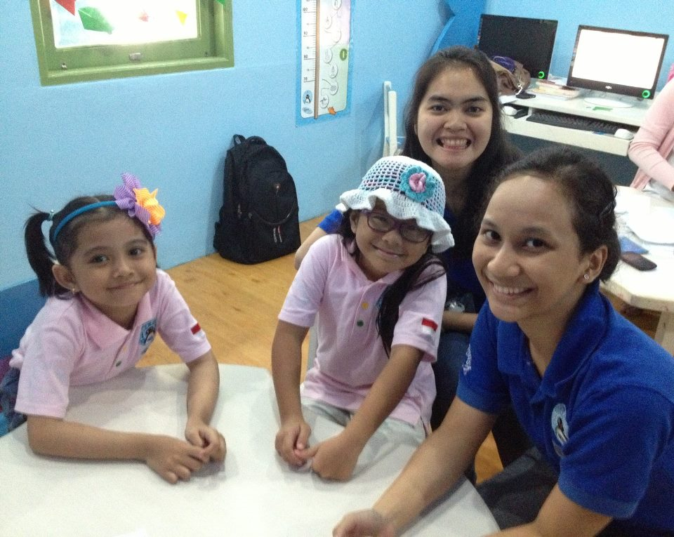 Level 3 students, Vicka and Nadhira enjoy their time in blue room class. They are very good in writing English.